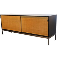 Credenza with Rattan Doors by Florence Knoll   From a unique collection of antique and modern credenzas at https://www.1stdibs.com/furniture/storage-case-pieces/credenzas/
