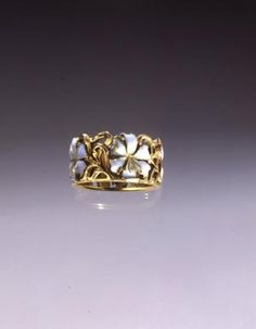 René Lalique. 1899-1900 Lily Ring. Gold, opaque enamel on gold. 1/2 in high; Diameter: 3/4 in