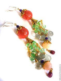 Купить или заказать Серьги 'Забава' в интернет-магазине на Ярмарке Мастеров. Это украшение-совершенно очаровательная вещица......поднимающая настроение, как своей хозяйке, так и окружающему миру)... Яркие,ослепительно женственные серьги... 2 цвета металла ( под золото и под серебро)..природные сказочные самоцветы...ажурная кружевная фурнитура...кокетливые звенящие цепочки с каплями драгоценных камней....... исключительно милая ЗАБАВА, созданная для радости и хорошего настроения)..
