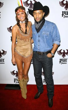 ChrissyTeigen.JohnLegend.jpg -- It looks like cowboys and Indians can get along! John Legend and Chrissy Teigen looked hot to trot in their couple costume last year and put their own sexy spin on an old-standby at the STK and Coco De Ville bash on Halloween. Perhaps this year, they'll dress up as a bride and groom since they got hitched in September. (10/31/12) Credit: Getty Images