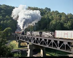 N&W 611 has broken clear of Cooper Tunnel and begins the climb to Elkhorn Tunnel over the former N&W Bluestone Branch, below the trestle, lower left. Once clear of Elkhorn Tunnel #611 will continue on to Iaeger, Williamston, and Kenova before calling it a day at Portsmouth, OH.