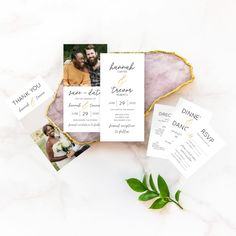 Flat lay of the complete Simple Wedding Suite from the Martha Stewart for Mixbook Collection featuring rings, an invitation, rsvp card, thank you card and more.