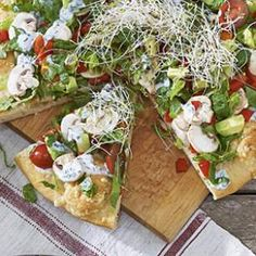 Loaded Garden Pizz'alad - Pizza topped with lettuce, bell pepper, avocado, mushrooms, tomatoes, alfalfa sprouts and herbs