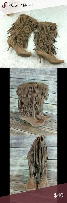 Moccasin style knee high suede fringed boots Awesome pair of Graceland knee high suede (material content translated from German) moccasin style fringe boots. Nice rounded toe box for comfort. Size (41 EU) US 9.5. Worn once around the house and at that time incurred a couple spots on the left boot. These spots do not detract from these awesome boots. Plastic tag barbs remain on the zipper pulls, but tags have been removed. No trades please. graceland Shoes Heeled Boots