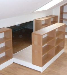 hidden storage behind bookcase in room with slanted walls (great idea for luggage)
