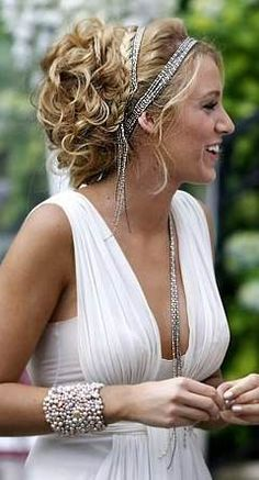 i would love to have my hair done like this with the headband and the bracelet for my wedding. If it was a beach wedding I want the top to look like this.