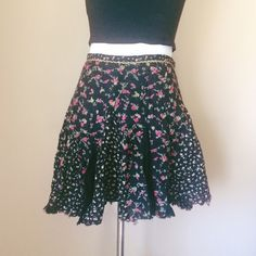 """Free People One black floral print skirt Gorgeous floral print skirt from Free People One. Two floral patterns on a black background make up this beauty, accented with a raw distressed hem and gold detail at the waistband. Zip and hook and eye closure. Unlined. 100% cotton. Size 8. Waist measures about 14"""" one way laying flat. Total length about 15"""". Worn once or twice and still in fabulous condition! Free People Skirts Mini"""