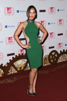 Alicia Keys in Stella McCartney hourglass dress with see-through sheer panels on the sides.