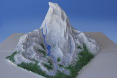 How to Make a Mountain Out of Paper Mache - make your mountain then ski down it - great for small world play.