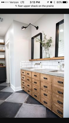 Ledge above sinks with leaner mirrors