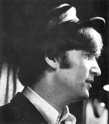 Beatles/John Lennon  And in my hour of darkness  She is standing right in front of me  Speaking words of wisdom, let it be.  Let it be, let it be.