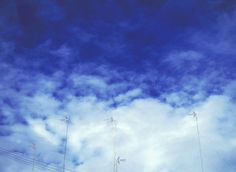 sky, cloud - sky, low angle view, blue, no people, electricity, power supply, technology, day, outdoors, built structure, nature, connection, architecture, electricity pylon