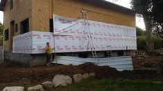 בניית בית לב בגת: התקנת חלונות