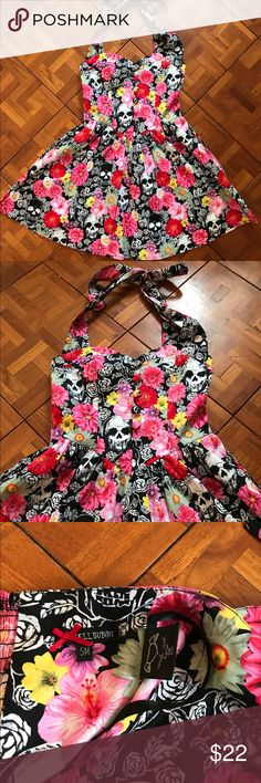Hell Bunny Floral and Skull Print Dress Hell Bunny Floral and Skull Print Dress. Like new. Super flattering balconette style top. Buttons down the front.  Halter strap around the neck. Zip up back. So cute. Love this dress but I needed a bigger size ... Hell Bunny Dresses