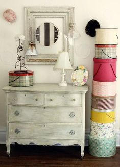 Distressed dresser.  The vintage hat boxes are a really nice touch.  #vintagebedroom #antiquebedroom #vintagedecor
