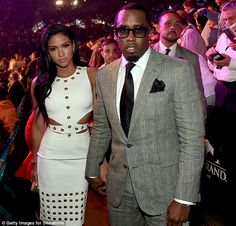 Fight night: Model Cassie Ventura (left) and P Diddy posed ringside as they entered the ar...