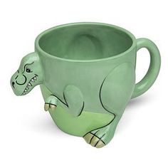T-Rex Mug. Just like we imagine of the real <em>T. rex</em>, this guy has stubby little arms sticking out the front and a convenient handle on the back.