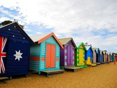 BRIGHTON BEACH HUTS - Brightly colored bathing boxes line the sand at Brighton Beach. Victorian morality created the huts, situated close to the shoreline so women could slip into their bathing costumes and race to the water discretely. Australia Beach, Australia Photos, Australia Travel, Victoria Australia, Melbourne Australia, Brighton Melbourne, Melbourne Victoria, Cabana, New Zealand