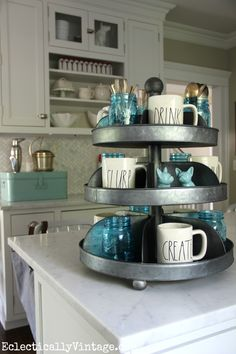 Get the farmhouse look in your kitchen with these great finds including an industrial tiered tray filled with blue mason jars eclecticallyvintage.com