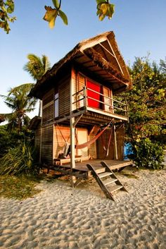 Tiny House on the Beach. The little home has three levels. When you walk into the first it's an open porch with a hammock to relax on. It's a tiny stick built structure with an upstairs balcony which is one of my favorite features. Living the Dream in a Tiny House on the Beach On the top level is where you can probably