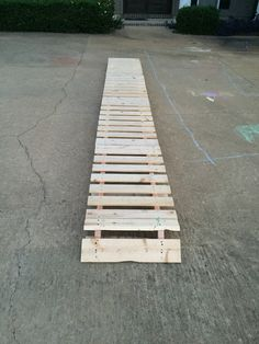 Bike pallet bridge. It's made from 2 4ft pallets cut in half.  Great for the kids to work on their balance.