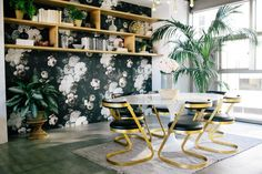 Lately, they're everywhere: huge, darkly dramatic floral wallpapers that draw you in with their lusciousness and sheer scale