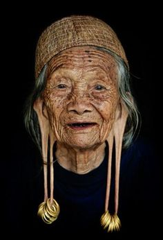 photo by Harjono Djoyobisono     Old woman from Dayak Kenyah tribe, East Kalimantan, Indonesia.    Women with long earlobes in Dayak Kenyah tribe are considered noble and respectable, while nowadays the tradition is no longer common among the tribeswomen.