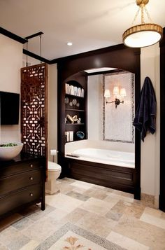 Minimal privacy: Have an interesting architectural artifact? If you have a random, flat architectural piece or textile, treat it as a screen. This Chinese screen is great looking and creates a stylish barrier between the vanity and toilet.