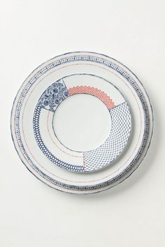 Sen-Gaki Dinnerware. This line work was inspired by the processes of Japanese woodblock printing. Porcelain and made in Portugal.