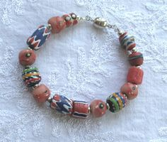 Here is a unique cat collar with hand made glass beads from Ghana. It features a magnetic safety clasp so your kitty will never get stuck. It