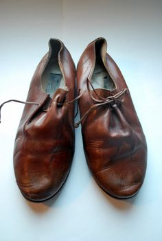 Minimalistically simple oxfords .vintage leather avant gard lace up shoes .8M and made in Italy. $36.10, via Etsy.
