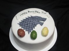 Game of Thrones inspired cake with the Dire Wolf and Dragon Eggs