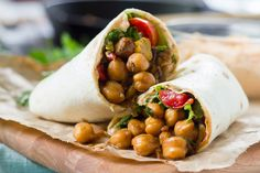 Spiced chickpeas are tucked into tortillas with a creamy aioli to make these easy vegan wraps.