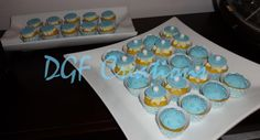 Mini cupcakes for boy baptism, vanilla with Swiss Meringue buttercream.  Covered in tiffany blue fondant, 3 different designs with unique hand crafted wrappers. www.facebook.com/dgfcreations