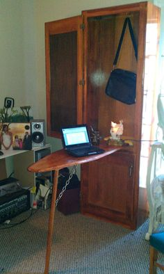 This ironing board cabinet has been repurposed as a desk to inspire me to take care of business!