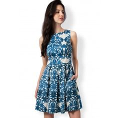 """We absolutely adore this dress! The damask print is such a classic and it looks gorgeous in blue and white for our  high neck, button back, pleated flare dress.  Mannequin wears size 8 UK/EU 36. Side neck to hem measures approx: 91 cm/36"""" Note: Print will not always appear as it looks in the picture. Machine Wash according to instructions on label: Machine wash, cold, should not exceed 30C. Iron, low. Dry Clean, any solvent except Trichloroethylene. Do not tumble dry. Do not bleach. Wash…"""