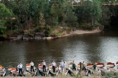 The groomsmen escort their partners to the boats on the Yarra River before the wedding reception.