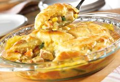 Roast poultry and vegetables are paired in a creamy sauce and topped with a golden biscuit crust.