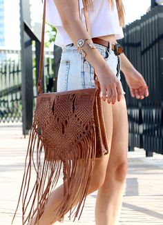 Hand-braided Moroccan leather fringe bag.  photo © Bárbara and João of www.picturesaftercoffee.com