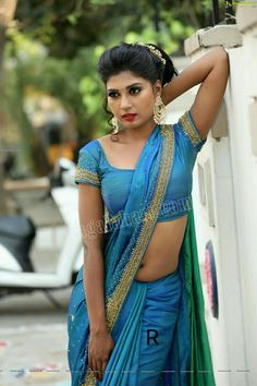 Saree has elegance that can never match any other outfit. Sanjana draped blue saree in style and the young lass looked so elegant. Bollywood Actress Hot Photos, Beautiful Bollywood Actress, Beautiful Girl Indian, Beautiful Indian Actress, Beautiful Women, Indian Beauty Saree, Indian Sarees, Saree Navel, Blue Saree