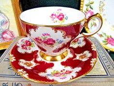 OFFERING THIS PRETTY TEA CUP AND SAUCER SUPER DESIGN MADE BY QUEEN ANNE CALLED LADY ELEANOR NICE RED COLOR AND FLOWERS AND ROSES MADE OF A FINE BONE CHINA WITH NO WEAR AND NO FADING PINGS NO CRAZING THIS IS MARKED AS SHOWN MARKED AS SHOWN AND IT IS VERY NICE WITH NO FLAWS THAT I CAN