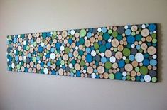 Wood slice wall art DIY, adding color changes this from rustic to WOW