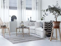 Bright scandinavian style living room in white, black, grey, and wood by Princess Interior