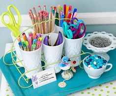 Cute idea for desk top old glass cups for pens scissors and office supply cute organization blue tray