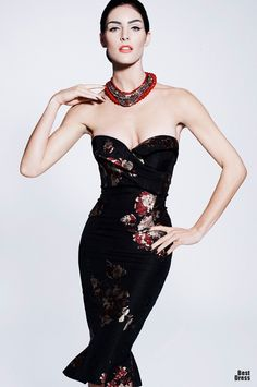 This is a Zac Posen 2012. Red white & black floral are hip for Spring 2013 as well.