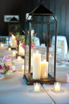 lanterns on the table put on half the tables with small clusters of flowers
