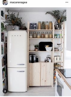 Summer style! SMEG refrigerator in a small kitchen!! Really clever size and love the wood shelves too - and the glass bottles as food canisters! IKEA is so useful in every home!