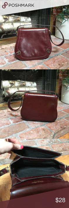 Vintage hand made Etienne Aigner purse Vintage handmade leather purse. Brown/red color. Purchased at a consignment shop but have never used myself. Two large compartments and one small zipped compartment Etienne Aigner Bags Shoulder Bags