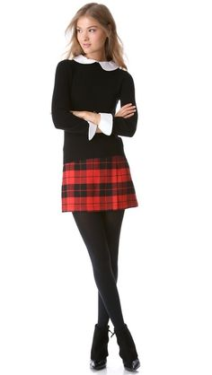 plaid with black sweater and white collar