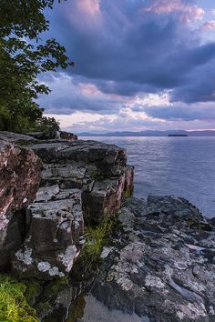 Sunset and clouds on Lake Champlain's shoreline in Vermont by Andy Gimino